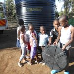 Children receiving tank donation